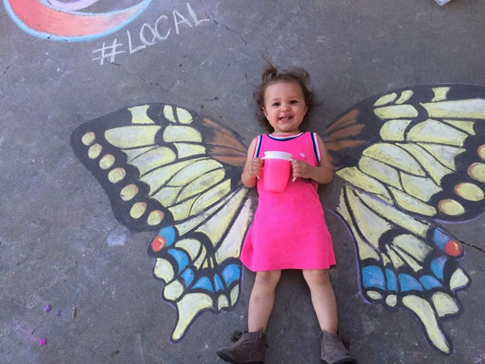 chalk art girl with wings